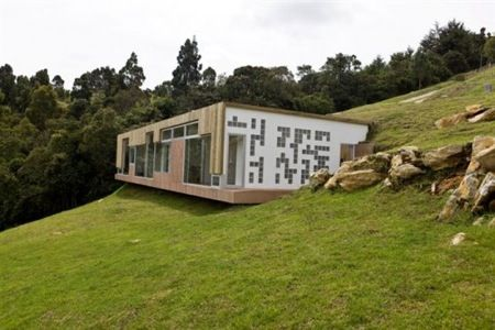 Hillside Home Design With Roof Entrance