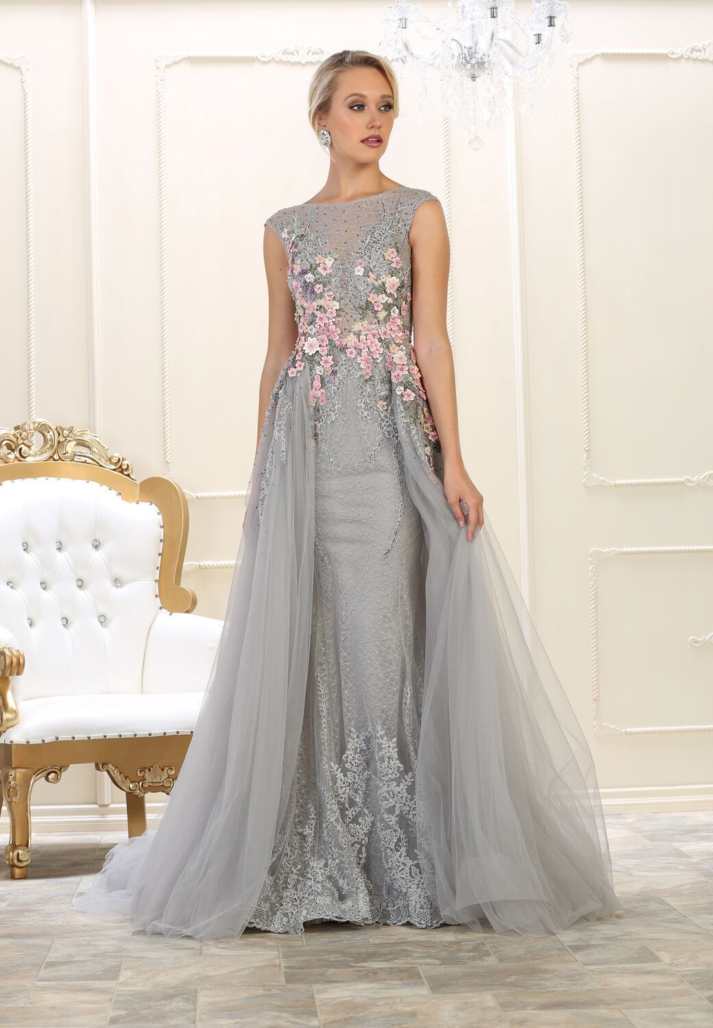 9eaac371f89 This elegant floor length dress features cap sleeve with embellish flowers  and tulle material. Perfect for prom