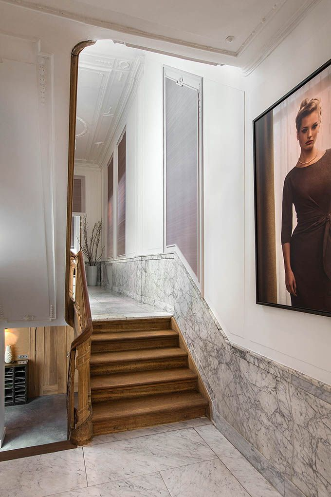 Utterly divine combination of wood stairs with marble floors and walls