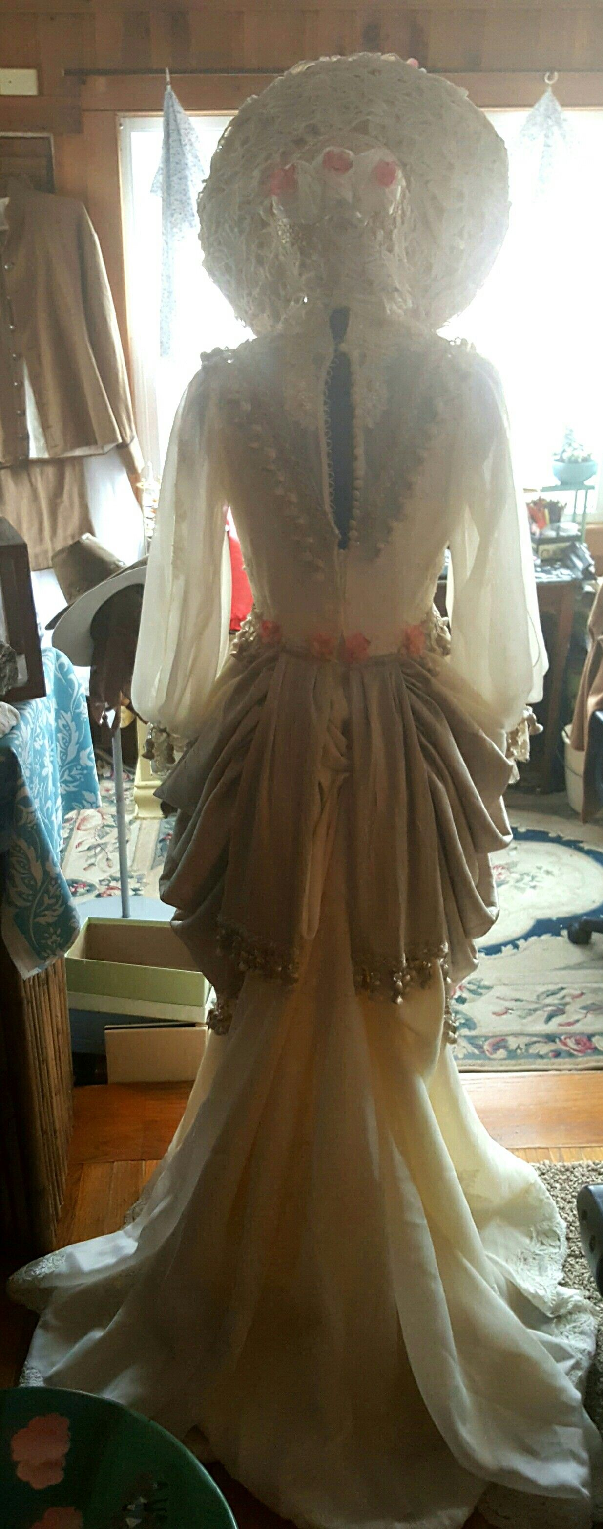 Bsck view - Refashioned an old wedding gown into a post Civil War Southern Belle costume. We'll have a full hoop underneath and ribbon ties on the bonnet