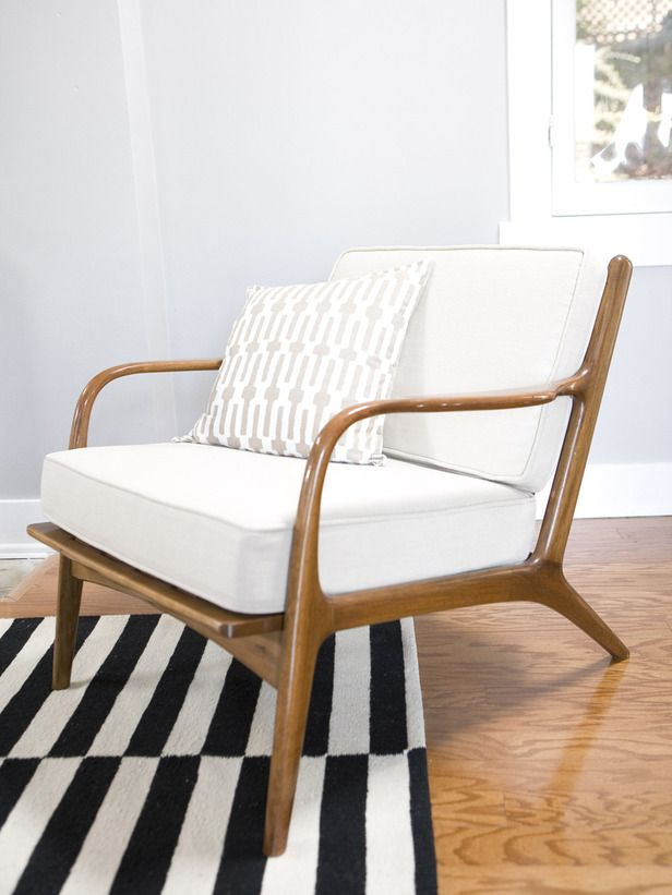 Classic Retro Accent Chair Of Warm Wood As Textured Neutral Fabric.