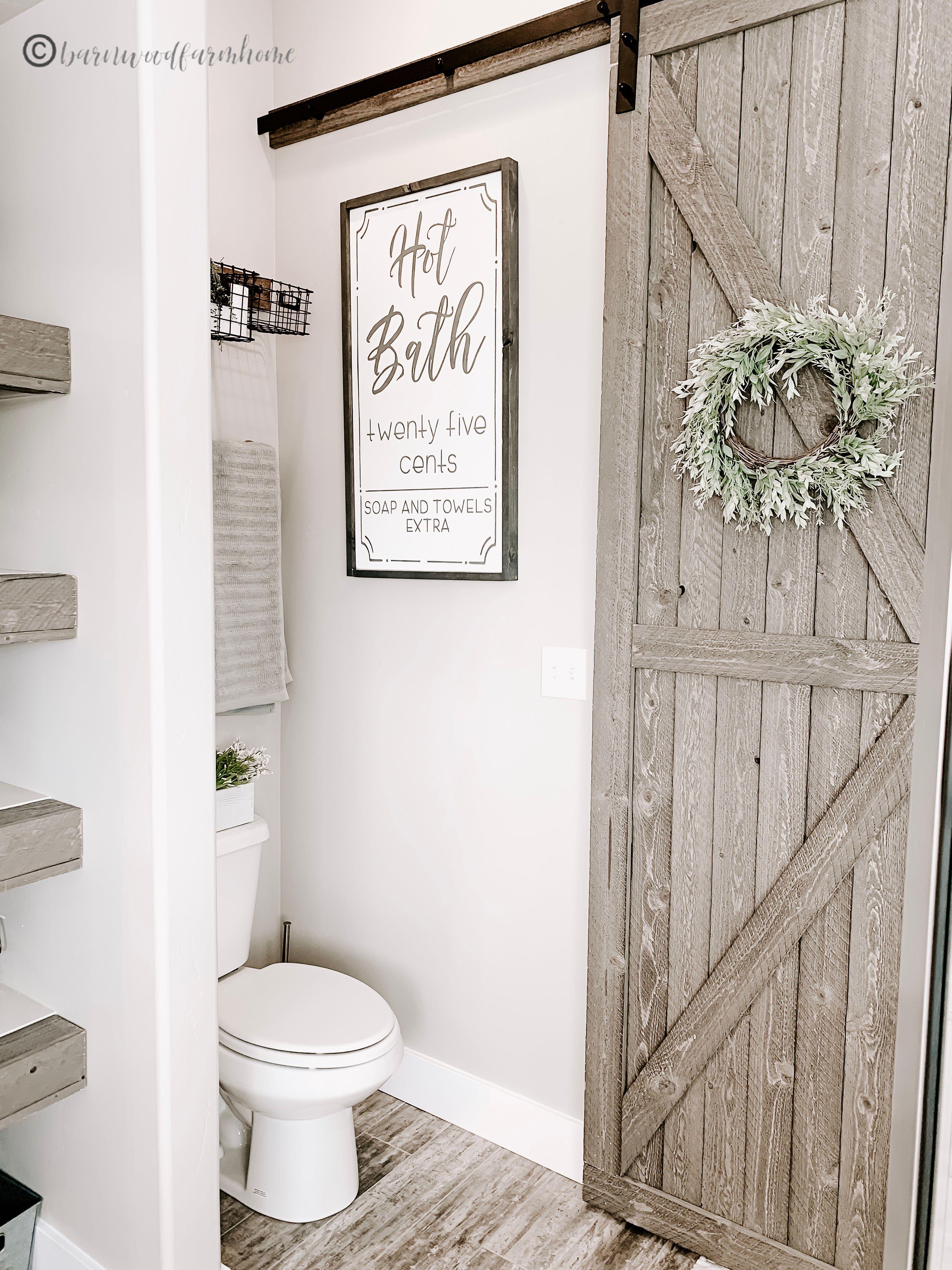 Farmhouse bathroom style with DIY barn door and barnwood