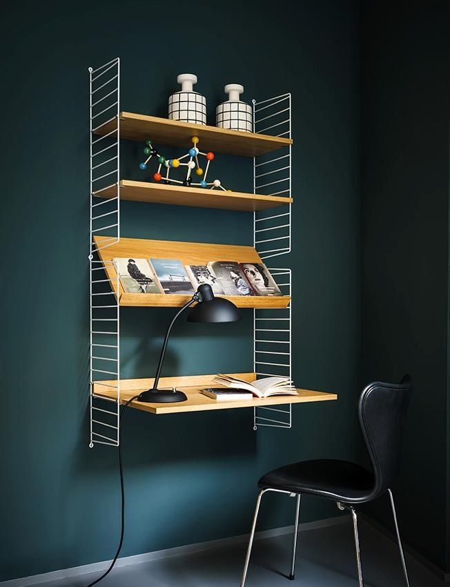 Deeper shade of Emerald green as wallpaper works well with Neutrals or colorful items. STRING shelf system & accessories, MOLECULES BUILDING SET by Ferm Living on second shelf.
