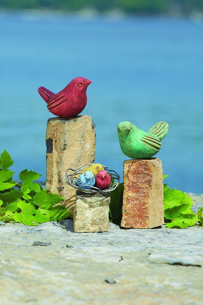 Birds on Rocks Garden Statue  Set of 3 is part of Container Rock garden - Birds on Rocks Garden Statue  Set of 3 Add a charming touch to any indoor or outdoor display! This set of three birds on rocks features two large birds and a wire nest filled with a colorful trio of fledglings, all tidily mounted on geometric stones of different heights  Perfect for the porch, patio, or flowerbed, they're also fun for tabletop use  Like all sculptures from the Happy Gardens collection, this whimsical set has been individually handcrafted, and will bring lasting beauty to any setting   Three stones with birds  Assorted colors  Dimensions 7  L x 4  W x 5  H, 7  L x 4  W x 8  H, 7  L x 4  W x 10  H