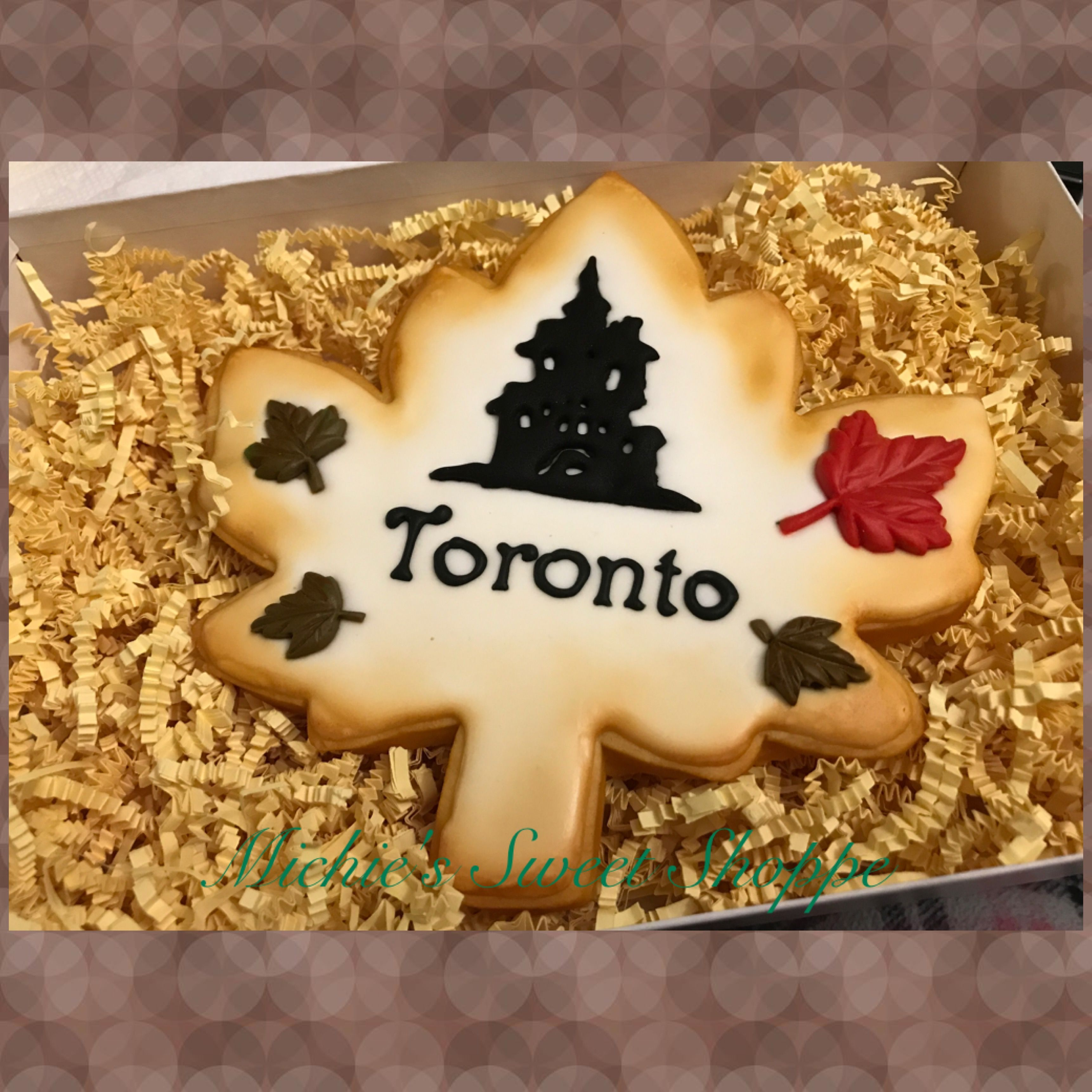 Toronto maple leaf decorated sugar cookie Victorian house Halloween - Halloween Decorated Cookies