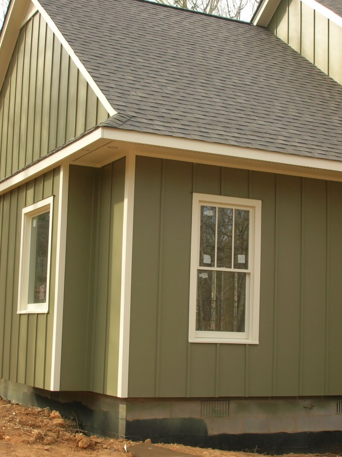Board and batten siding green board batten siding with for Metal shiplap siding