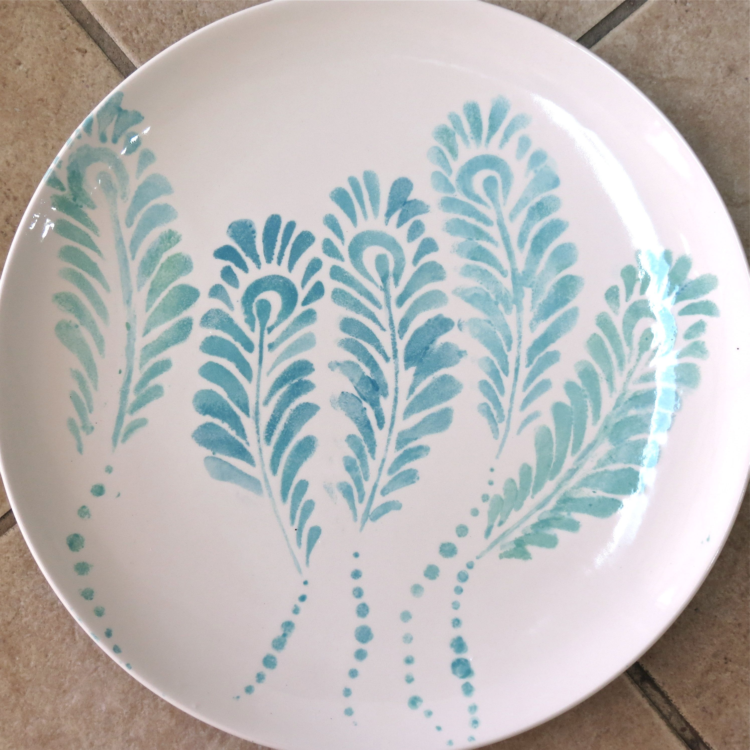 Peacock Feathers stencil - made by Balzer Designs and The Crafter's Workshop - Plate made at paint-your-own pottery place. @Julie Fei-Fan Balzer @Jaime Echt