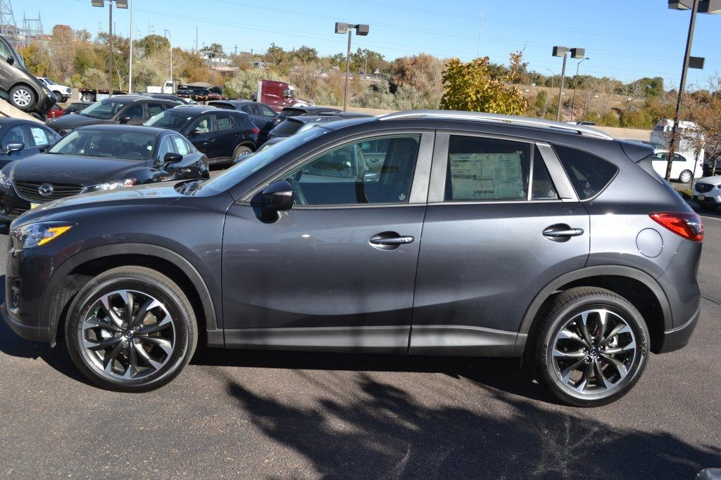 This is a new meteor gray mica 2016 Mazda CX5 Grand