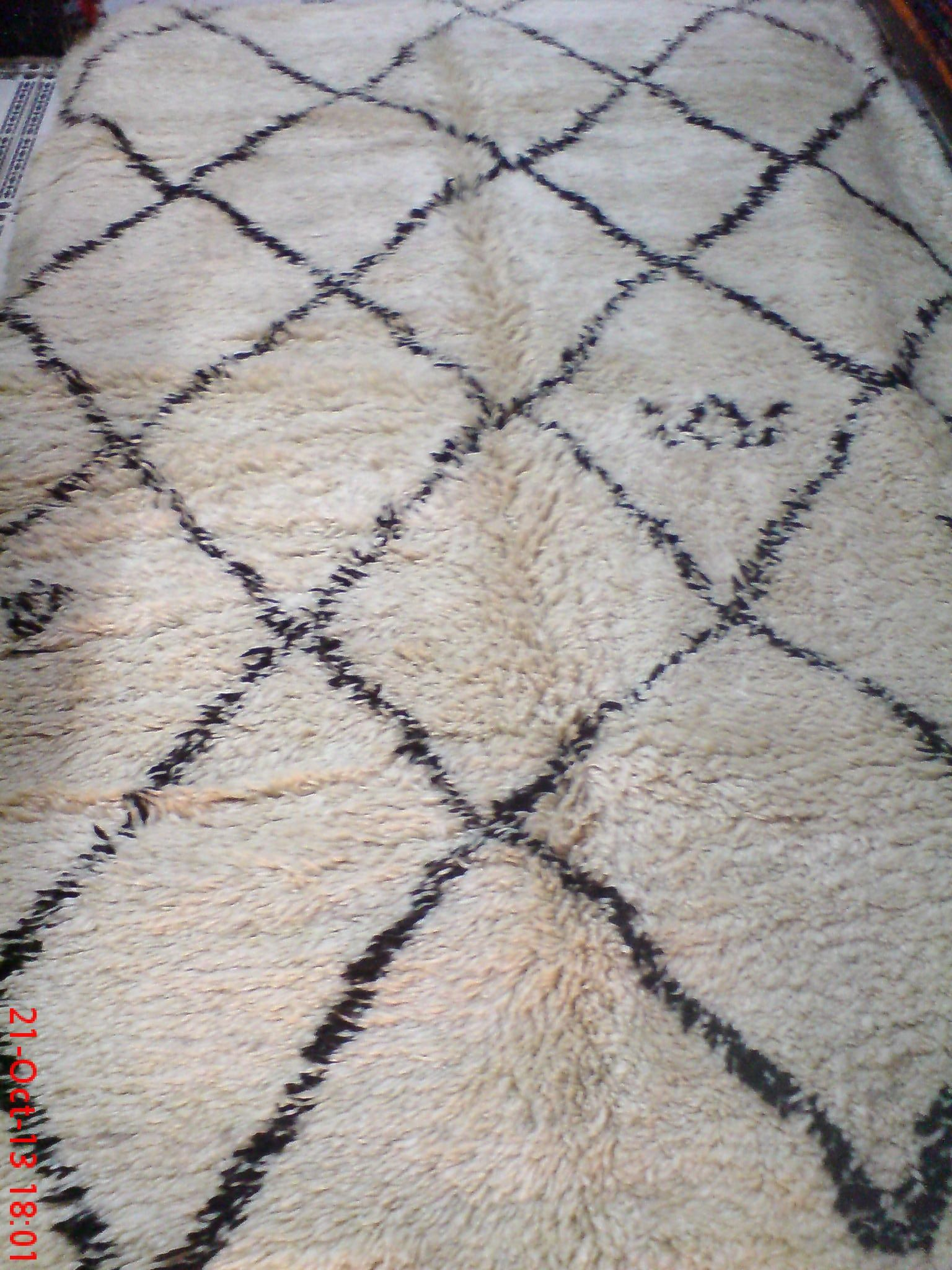 Beni Ourain rug with tribal markings. 2M x 3M Beni