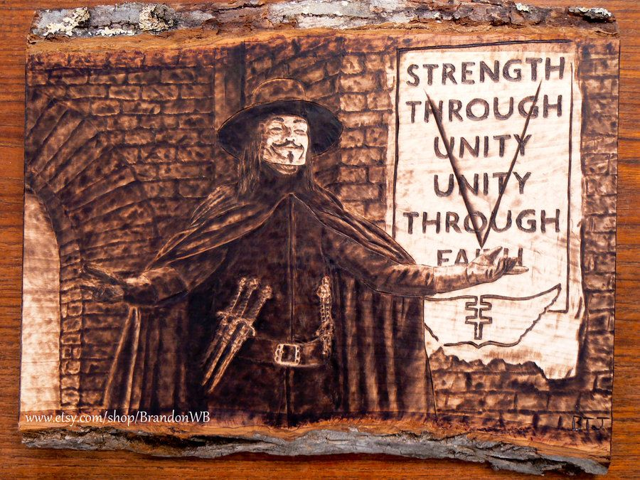 V for Vendetta. Incredible art work. He made this by wood burning.