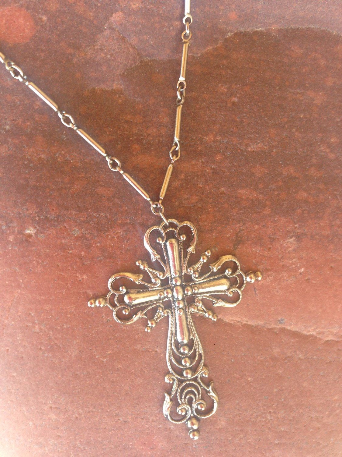 1970's Filigree Cross Necklace by luckyhandvintage on Etsy https://www.etsy.com/listing/385017066/1970s-filigree-cross-necklace