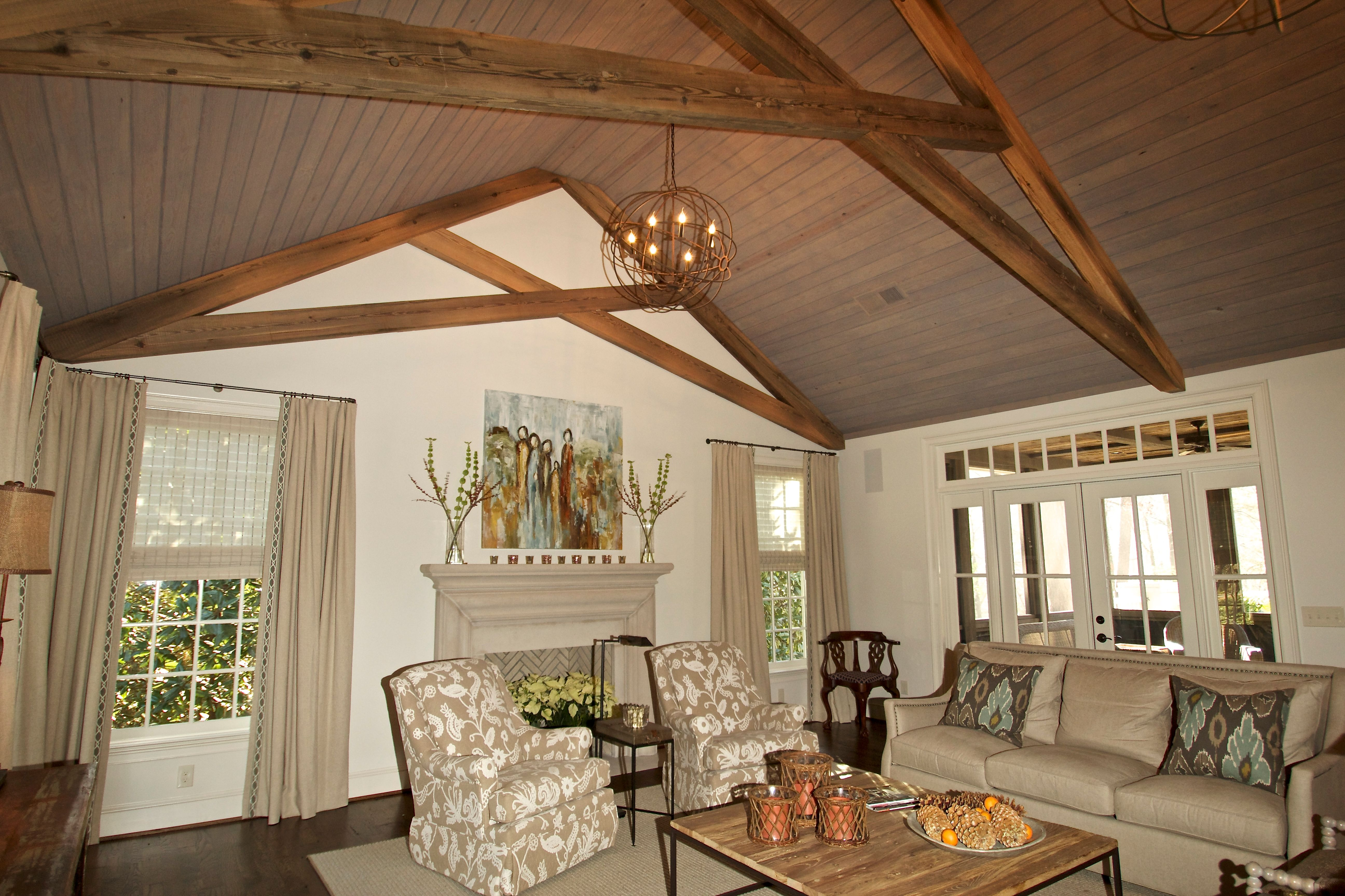 Den Addition with scissor trusses from reclaimed sunken pine and ...
