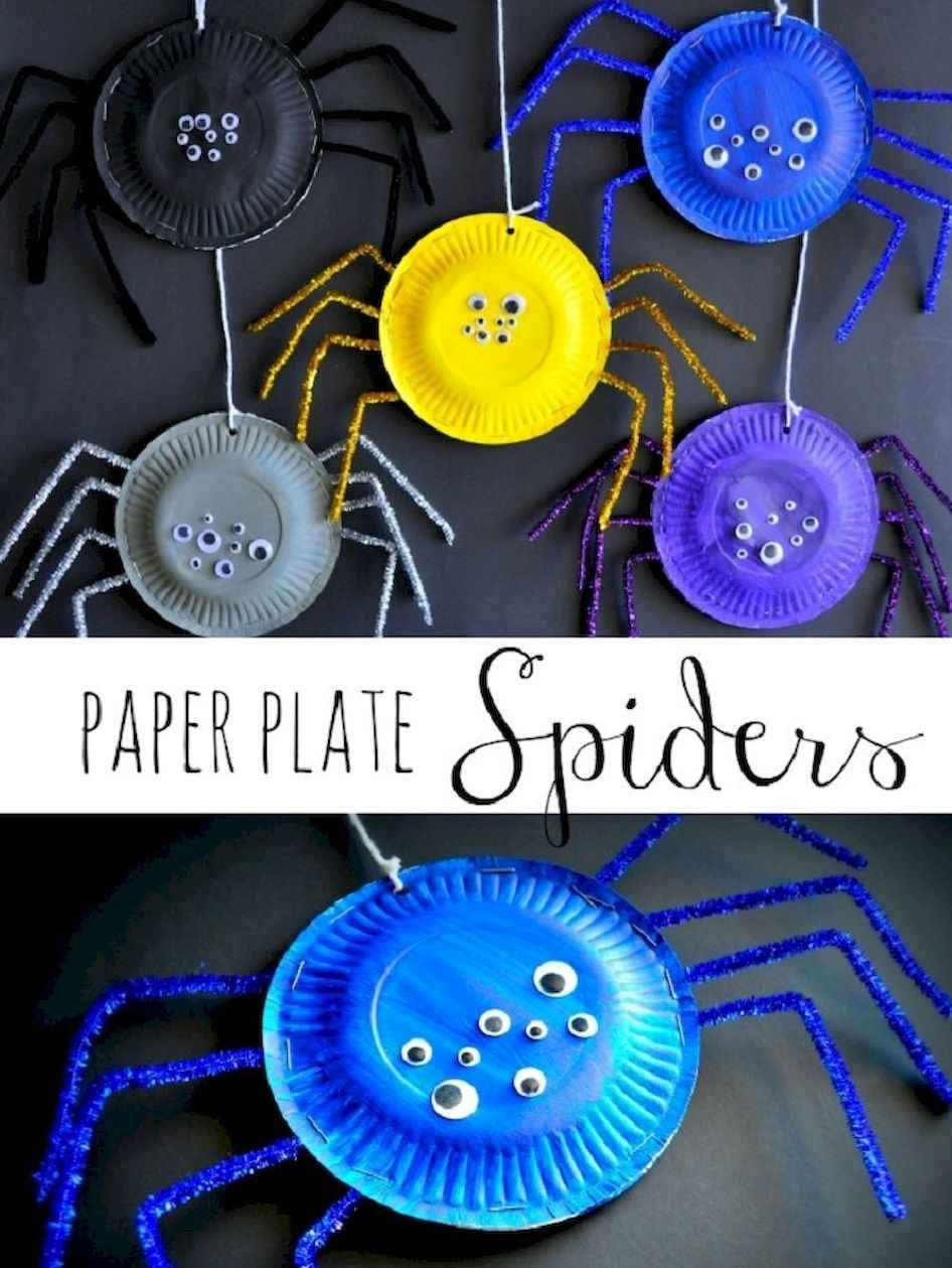 add white fluffy stuff on wall to hang the spiders from