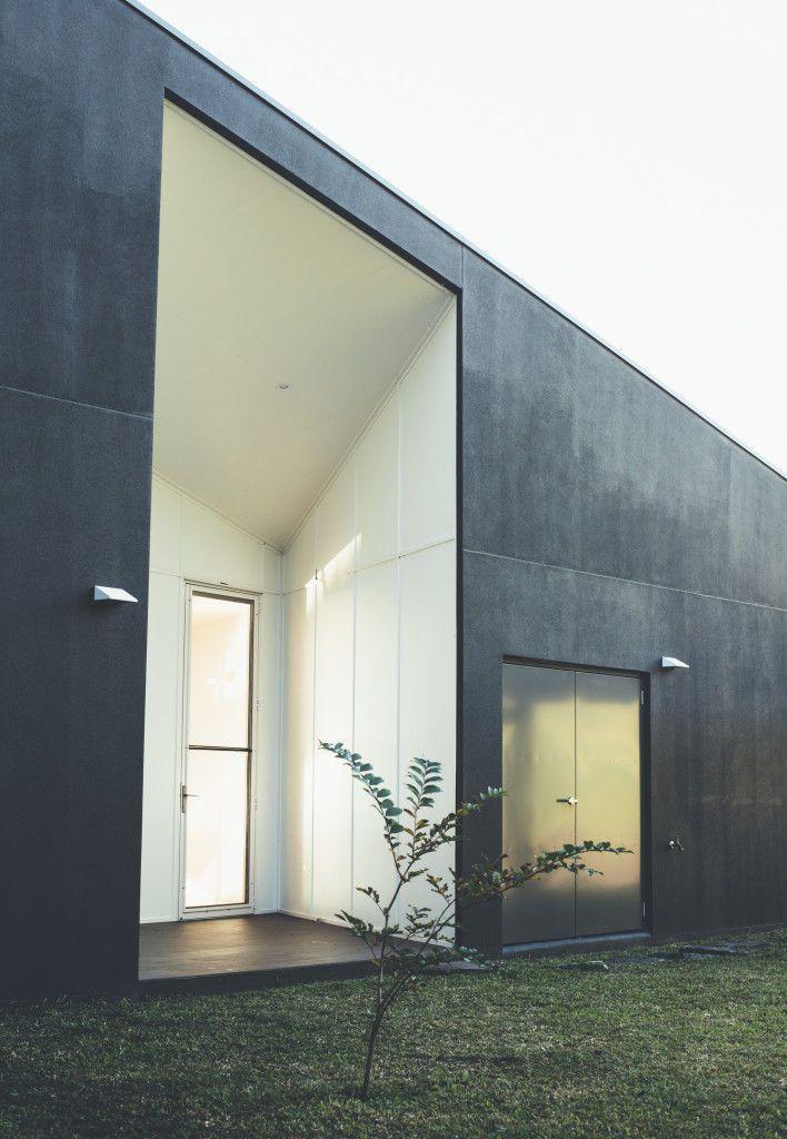 White front door on a dark facade