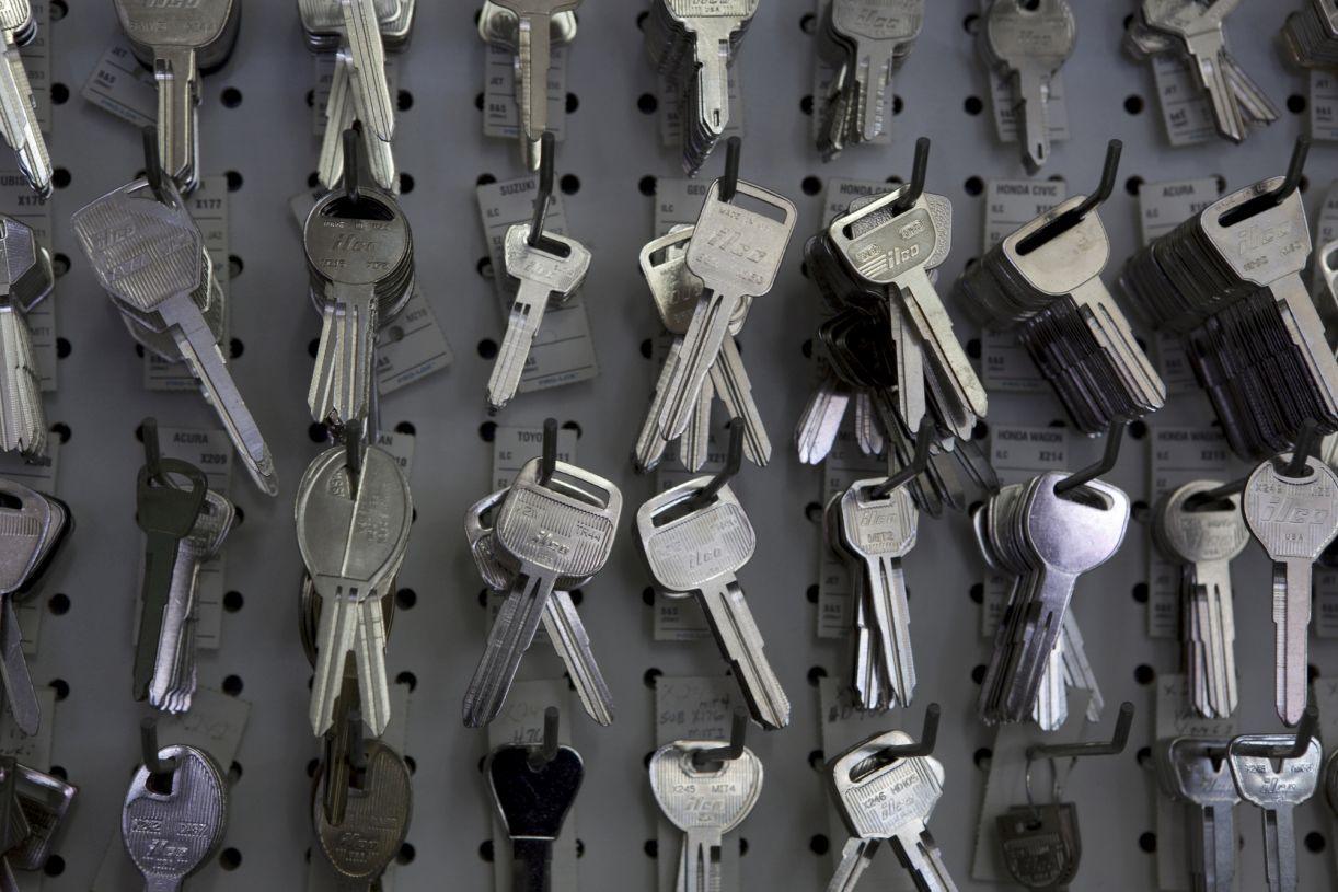 Keys hanging on hooks in store Locksmith, 24 hour