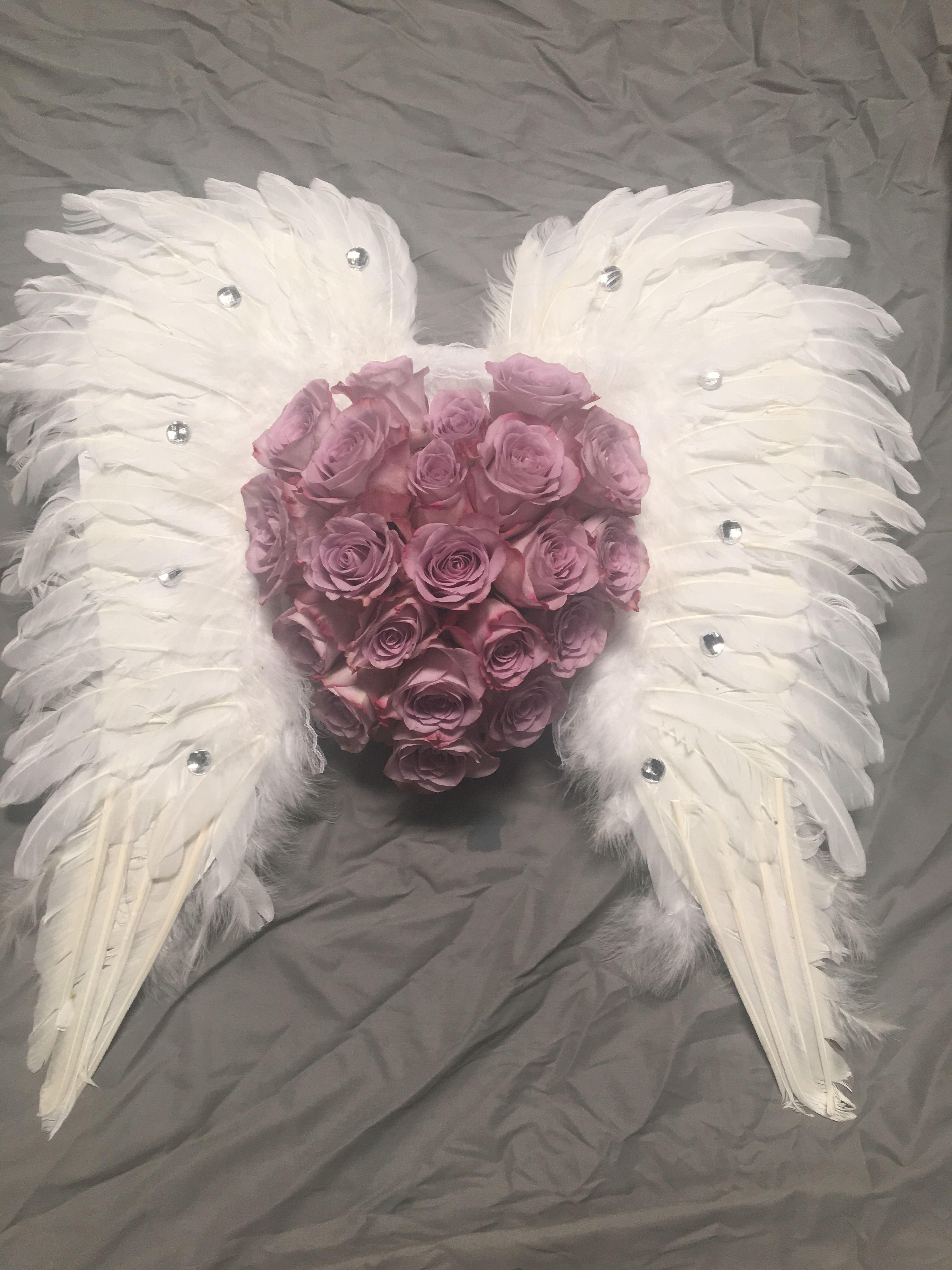 Angel wings funeral flowers abi pinterest funeral flowers angel wings funeral flowers izmirmasajfo