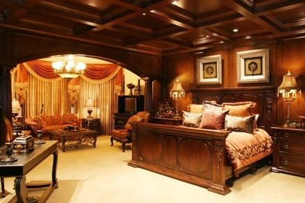 Master bedroom with custom ceilings and banisters.