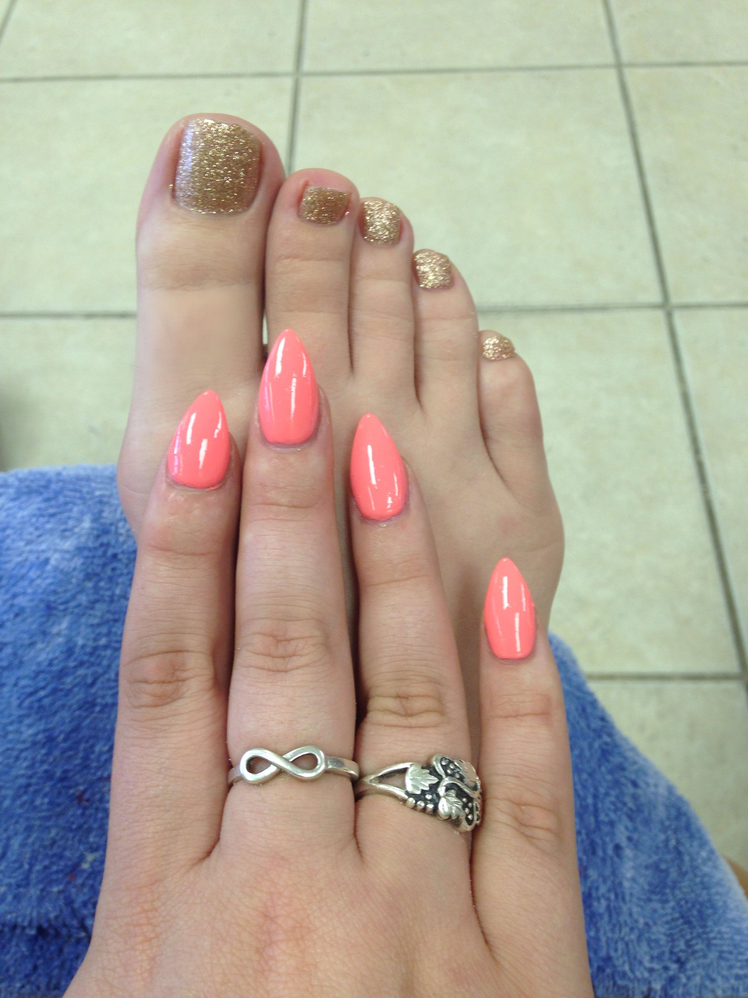Coral-pink stiletto nails and gold toes. Done by Henry at Kristy ...