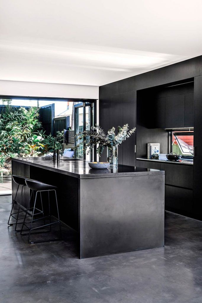 Photo of Concrete bench and flooring merge with Polytec joinery in Black Natura.
