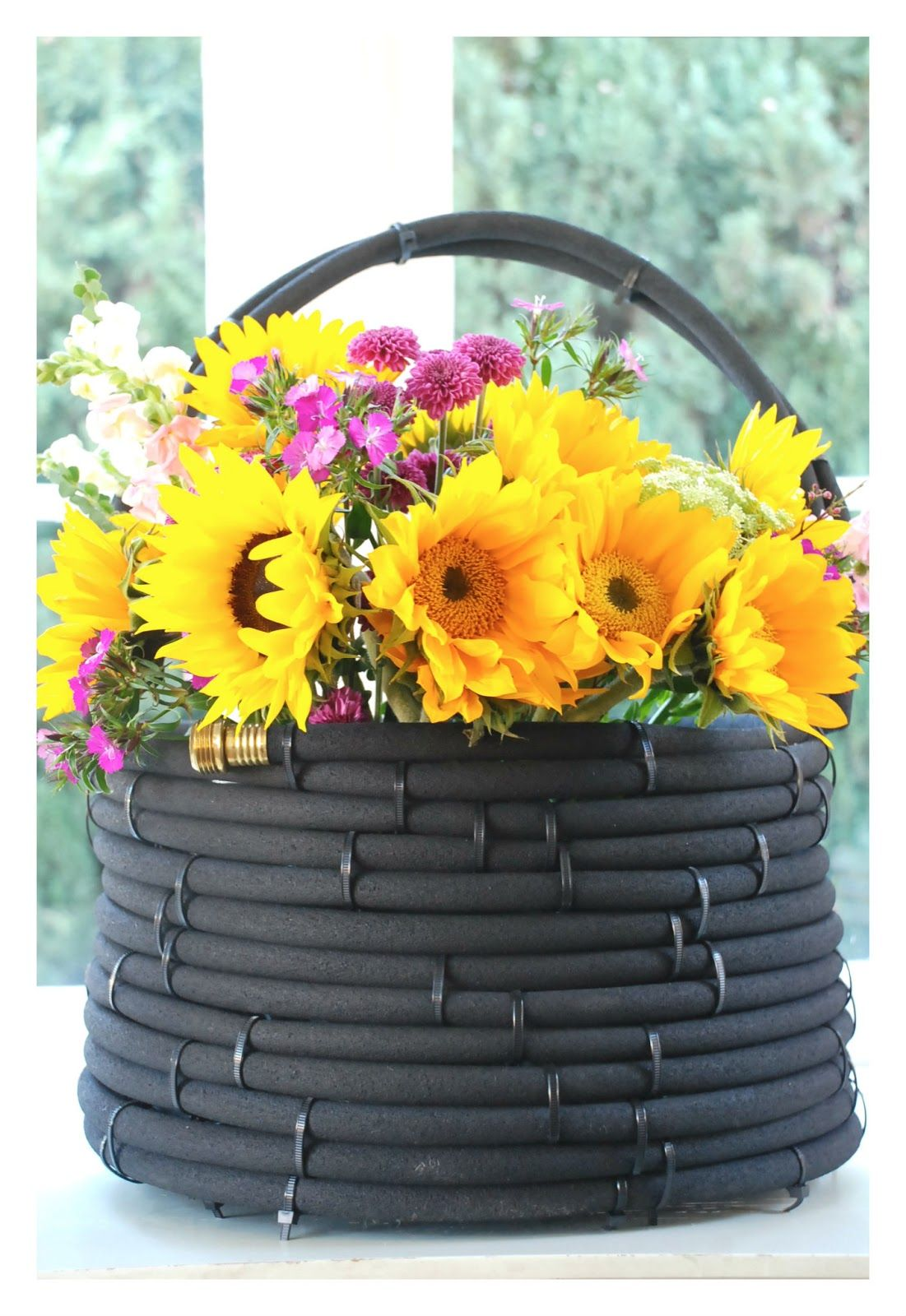 A garden hose basket from this american home blog
