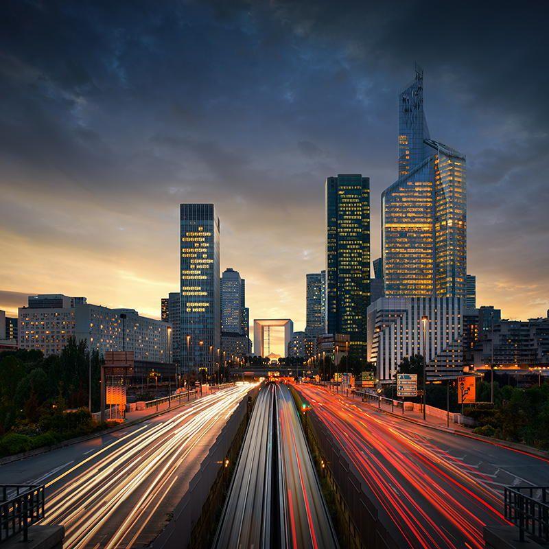 http://parisbytrain.com/wp-content/uploads/2014/02/paris-la-defense-dusk-car-lights-long-exposure.jpg