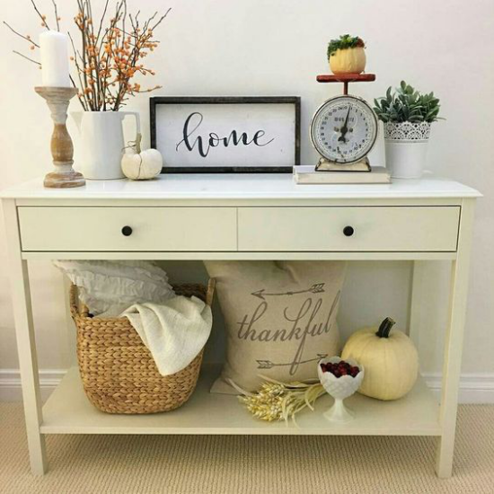 Decorate the console table autumnally and bring back pumpkins,