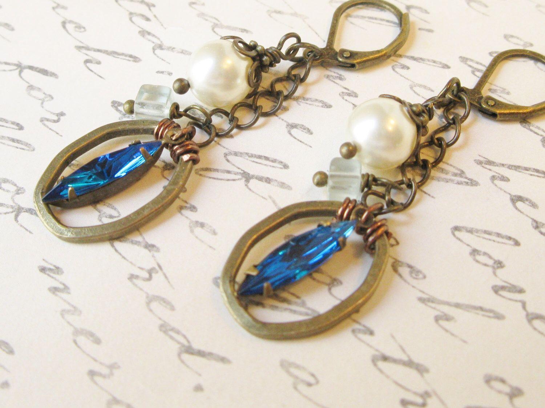 A personal favorite from my Etsy shop https://www.etsy.com/listing/225884668/rhinestone-and-pearl-boho-earrings-capri
