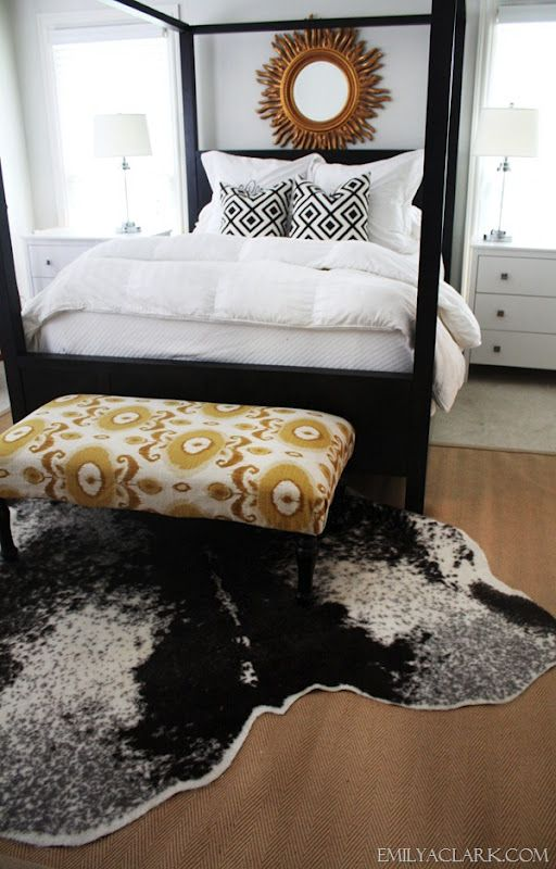 Cowhides Layered Over Natural Fiber Rugs Driven By Decor White Bedrooms