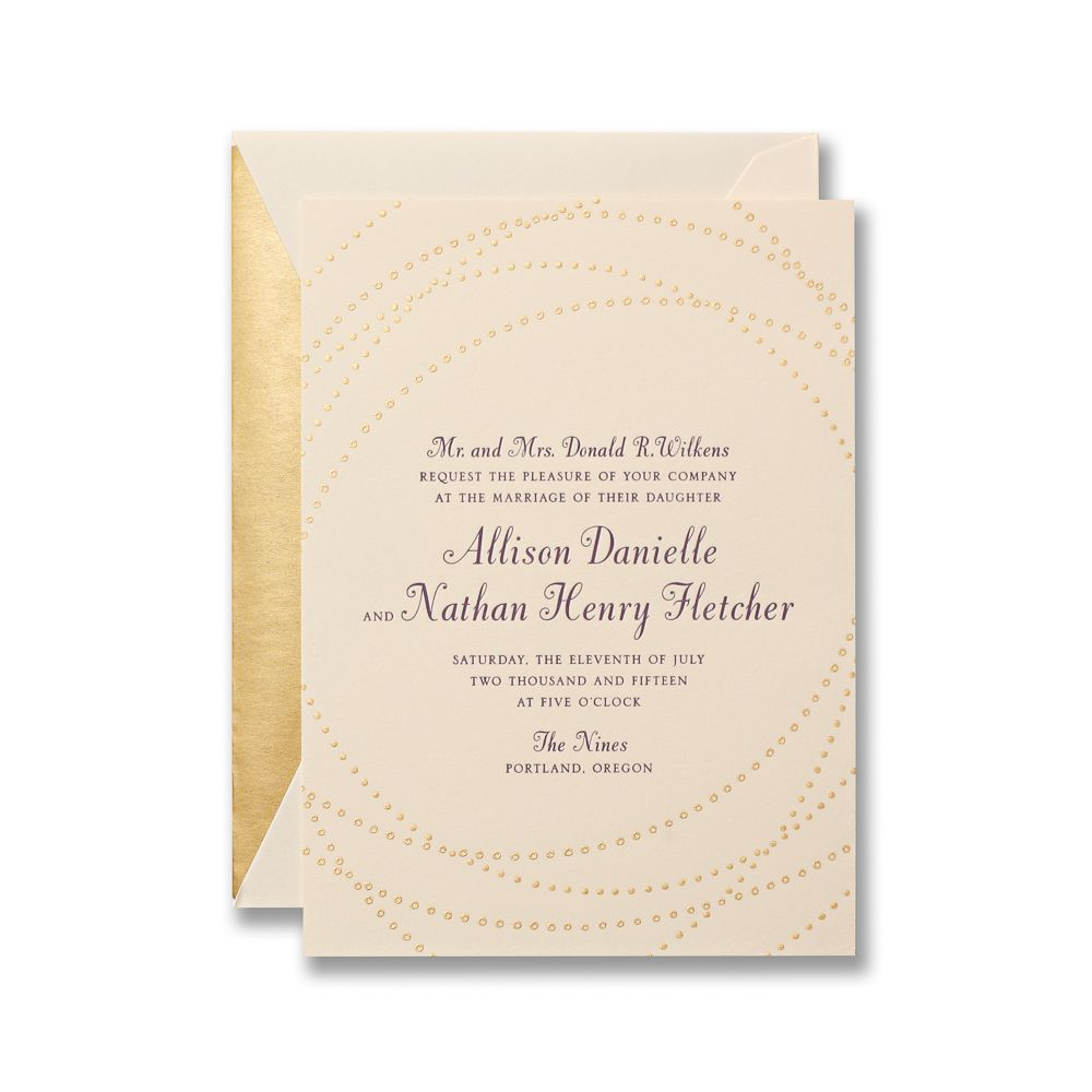 Letterpress invitation on lettra paper with engraved gold