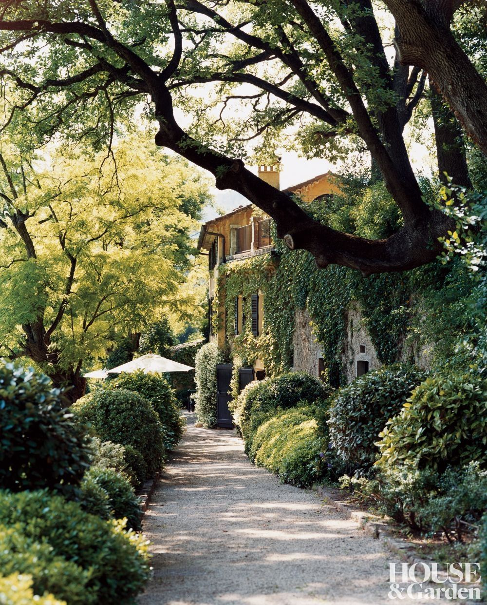 Mediterranean Exterior Of Home With Pathway Fountain: A Path Leads To Domaine Du Sault Rustic