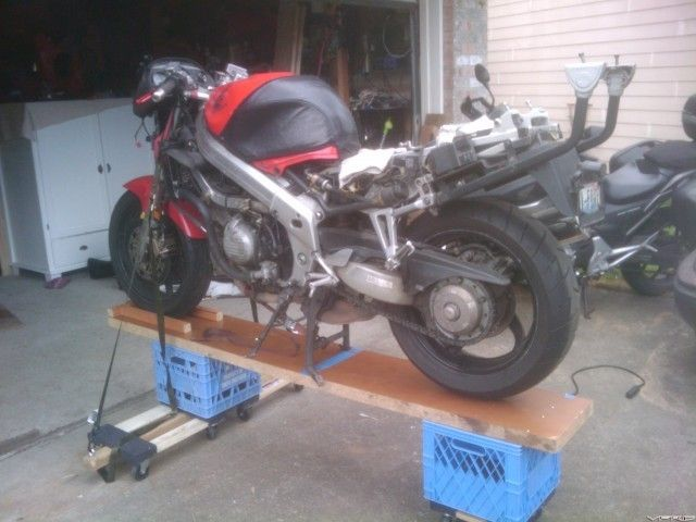 Mobile Motorcycle Workstand by V-FORE -- Homemade mobile motorcycle  workstand fashioned from a wooden plank, lum… | Homemade mobile, Homemade  motorcycle, Motorcycle