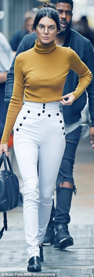Geek chic! Kendall's ensemble was a far cry from her usual sexy attire, as she teamed high...