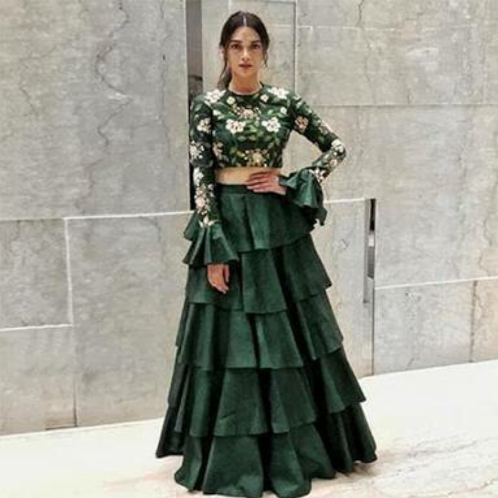 e2f711a8cbc13 green colour crop top with bell sleeves and lehenga with ruffles  on  peachmode.com