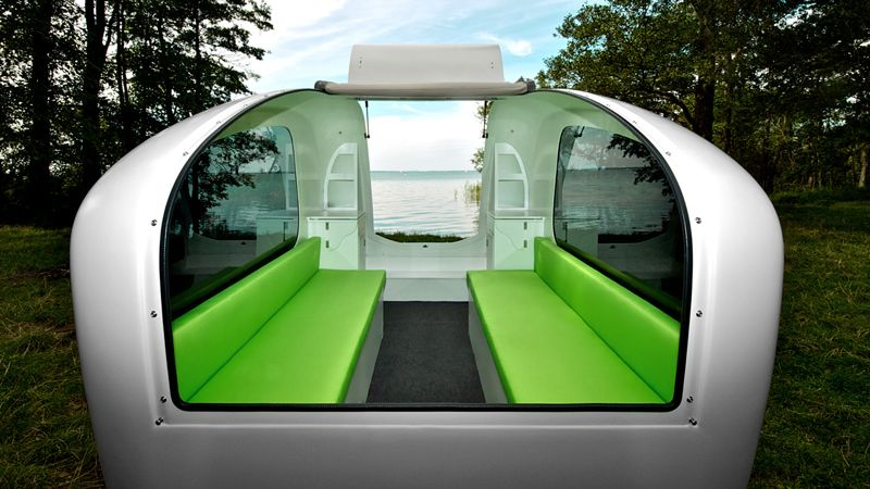 """""""The Sealander comes with a large sunroof, a fold-out table, and seating for six that turns into a bunk bed."""""""