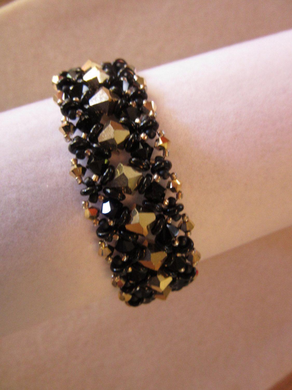 Gold and black crystal bracelet. Swarovski aurum gold and jet black crystal  bracelet. Handmade statement bracelet. Aurora borealis. by TreasuresFromDee  on ... 1511f91ebc