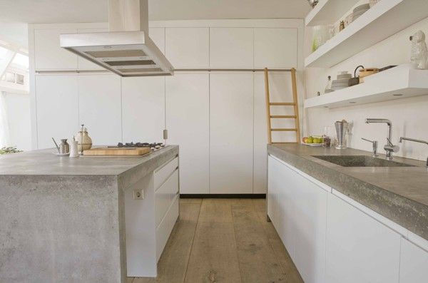 If we have to go for white, then this way: Clean kitchen, matte white (not glossy!) and concrete. High closets on short wall, work area (with no upper cabinets) on long wall. (kitchen)