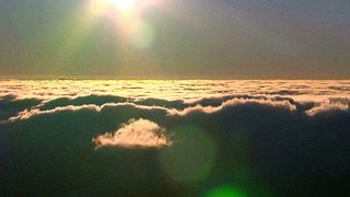 Stock Footage | Pull back on the sun as we float on top of the clouds. | Download using the VidLib app. 50.000 Royalty Free Clips'
