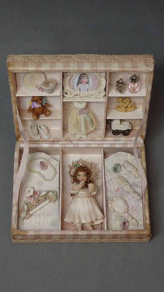 Peach colored miniature dollhouse doll in a box