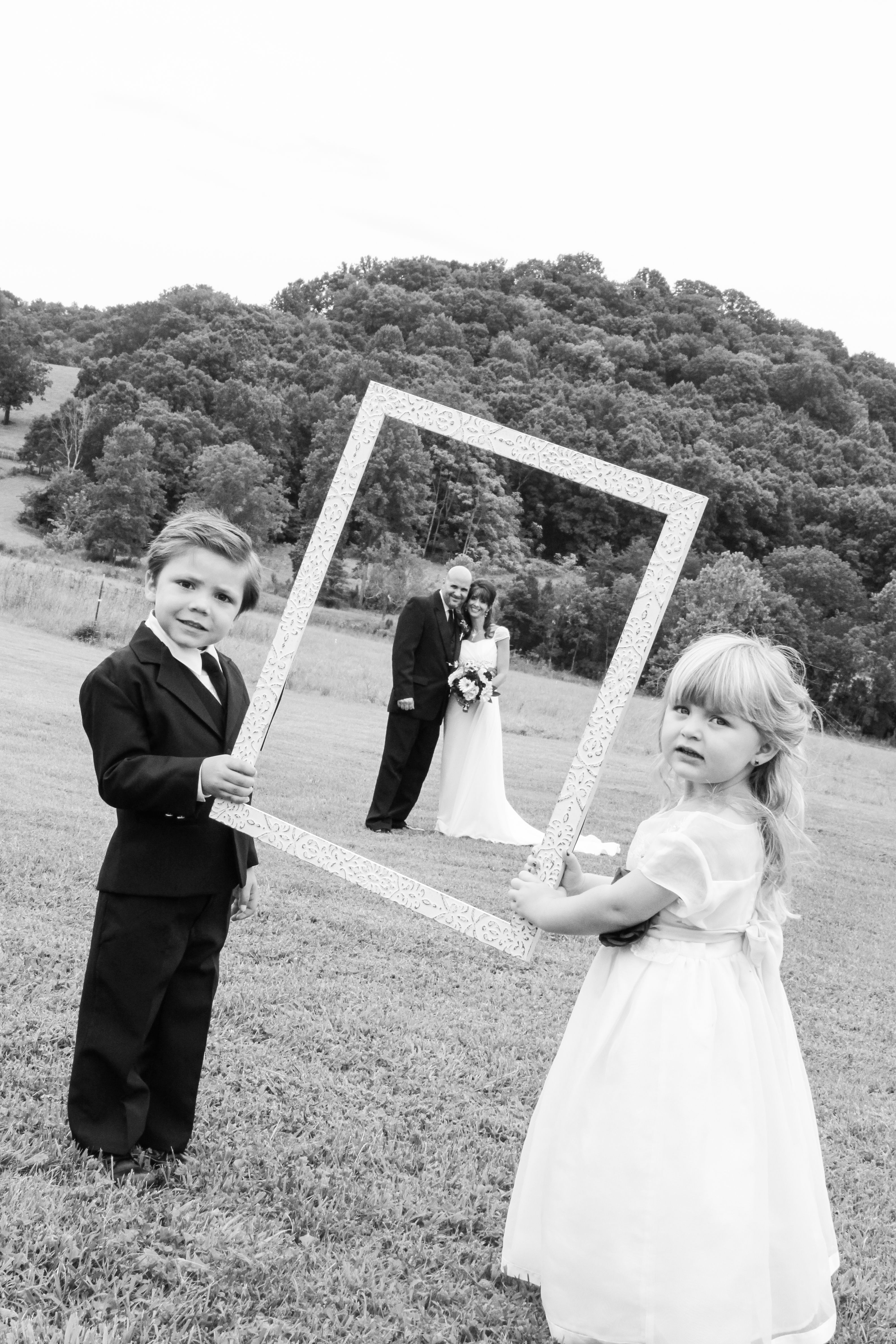 Photo Frame with the flower girl, ring bearer, and the bride/groom ...