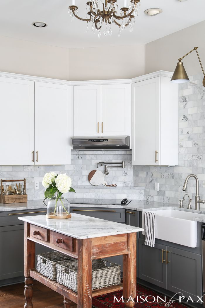 Two toned gray and white cabinets marble subway