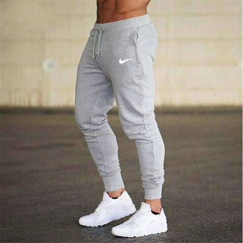 bfbcfa94839 Mens Fitness Brand Sweatpants Pant male Bodybuilding Jogging FK02 –  everyclothes  pants  mens  nikes  nikespants  2018  white