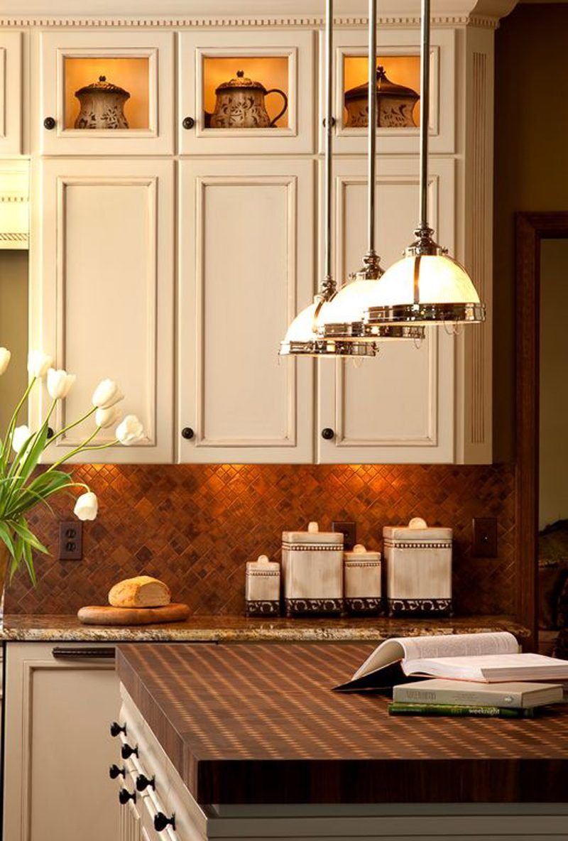 illuminated top glass cabinets with dentil molding and multi tone tile backsplash in diamond on kitchen cabinets with glass doors on top id=60043