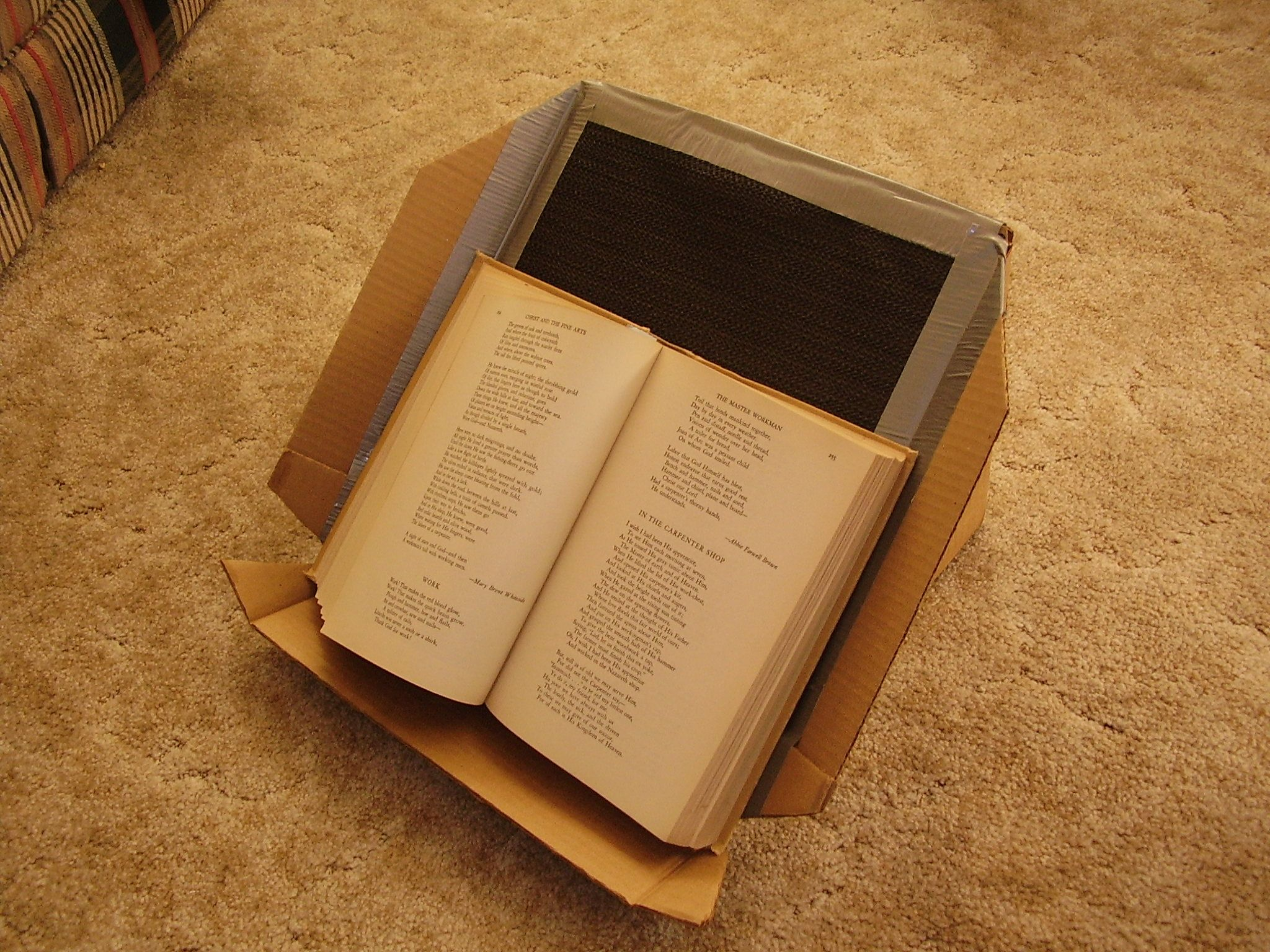 book holder from cardboard with taped on nonskid surface outreach