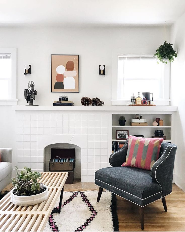 Mid Century Modern Boho Living Space With White Fireplace
