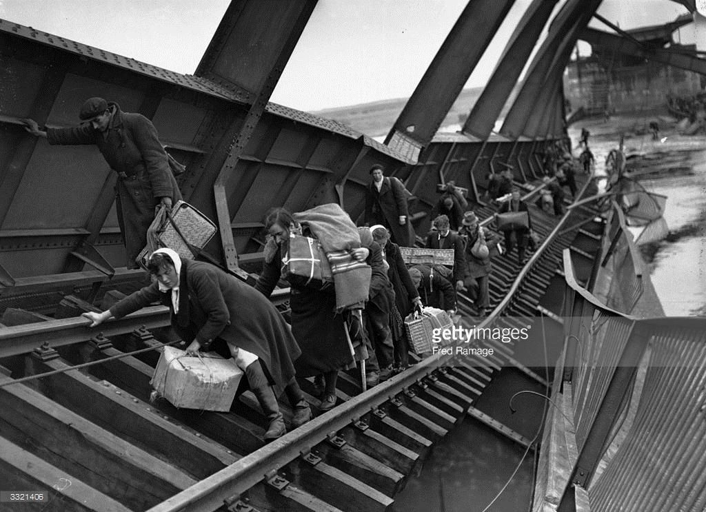 Refugees crossing a bridge on the River Elbe to escape the chaos behind German lines.