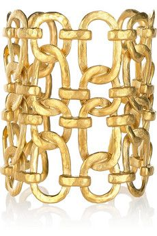 Statement jewelry adds instant drama to any look, and we love Kenneth Jay Lane's interlocked 22-karat gold-plated cuff for day or evening