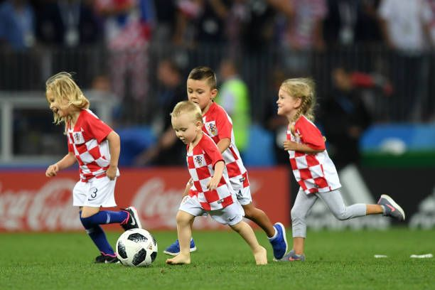 Children of the Croatia team play on the pitch after the 2018 FIFA World Cup Russia Semi Final match between England and Croatia at Luzhniki Stadium...