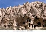Ancient tuff stone cave village with church in Goreme