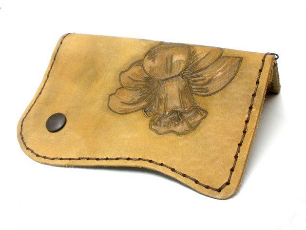 http://en.dawanda.com/product/109893159-flower-pyrography-tobacco-bag