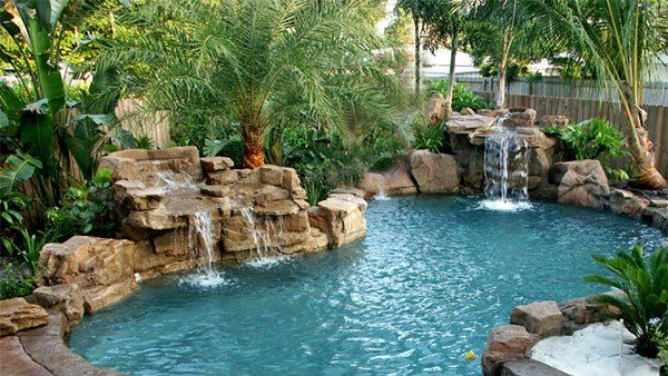 15 pool waterfalls ideas for your outdoor space. beautiful ideas. Home Design Ideas